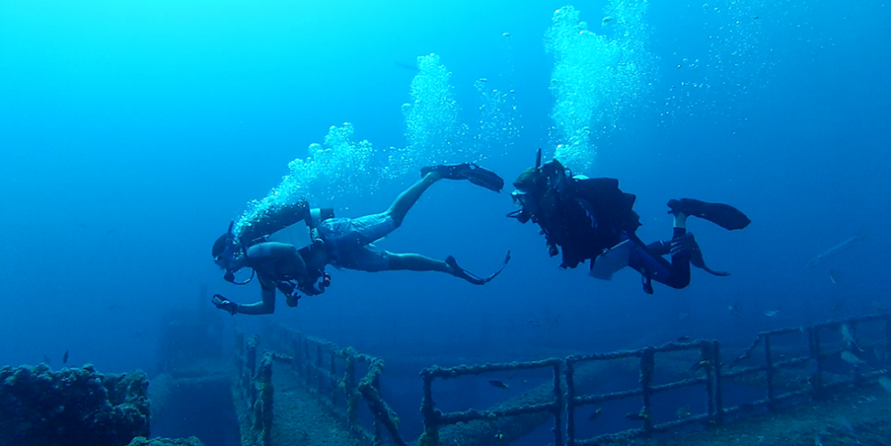 Two divers about to begin a fish survey on reef site MI-A-7, a cutoff platform.