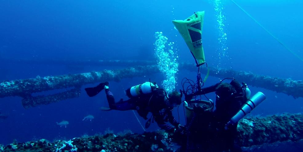 Scientists deploying a receiver at artificial reef MU-A-85